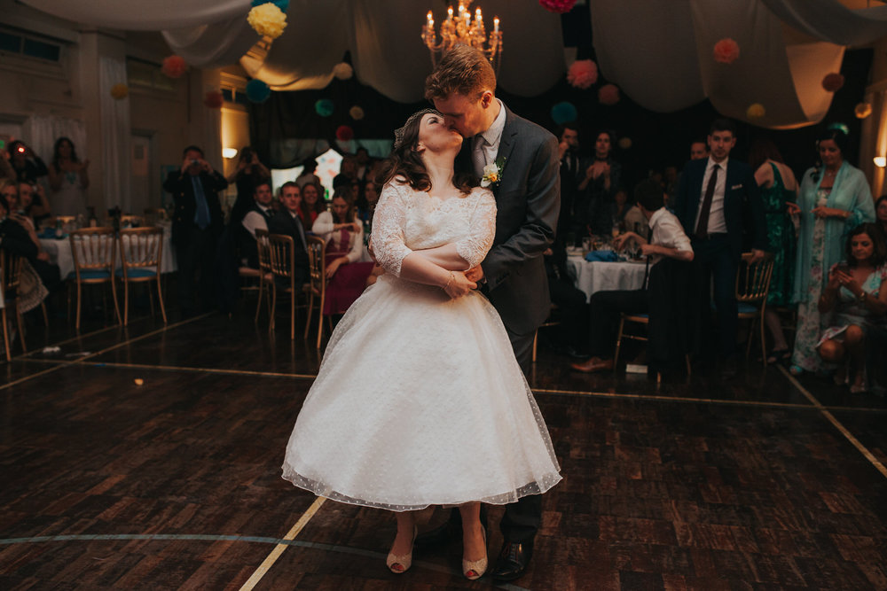 255 bride kissing groom during first dance wedding London.jpg