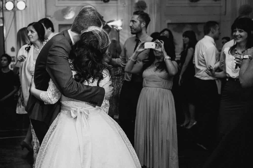 264 bride groom posing school hall wedding London.jpg