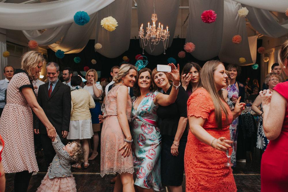 265 guest selfie school hall wedding reception London.jpg