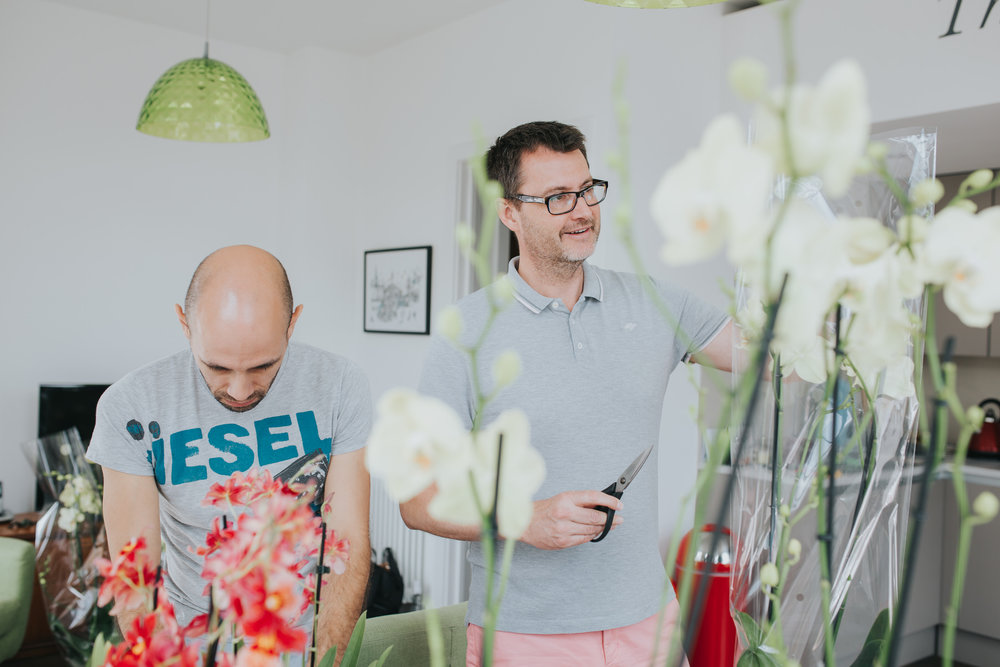 8 gay couple arranging yellow orchids for wedding.jpg