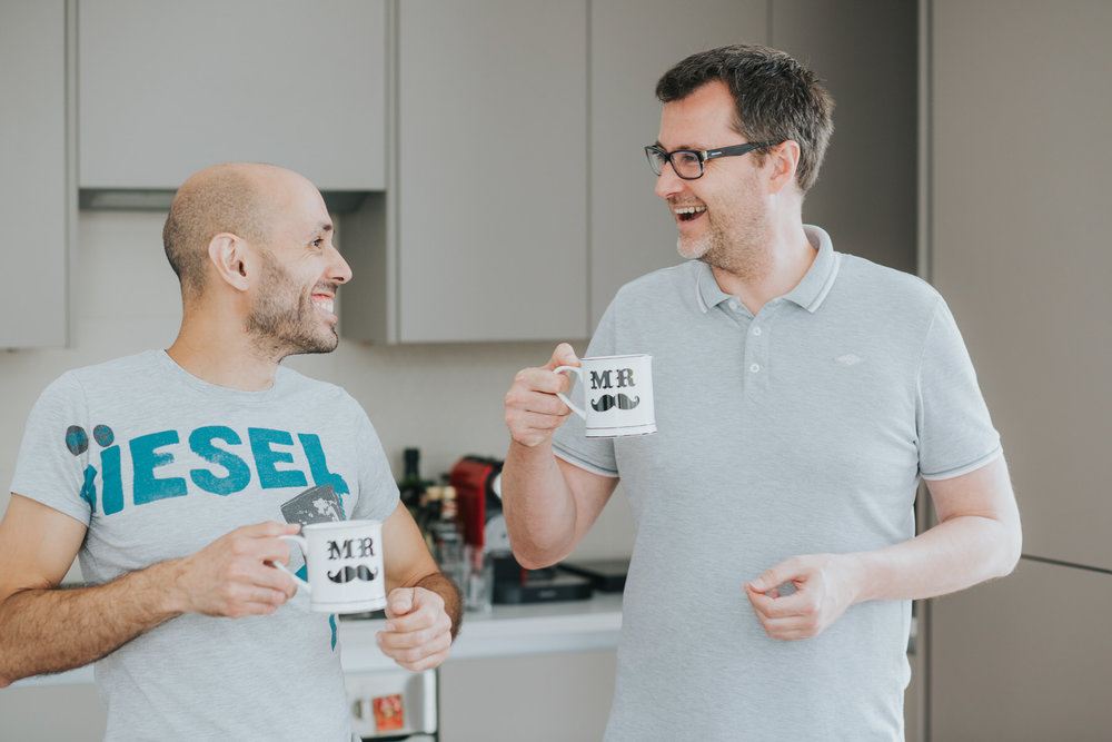 32 laughing couple drinking coffee out of white mr and mr moustache mugs.jpg