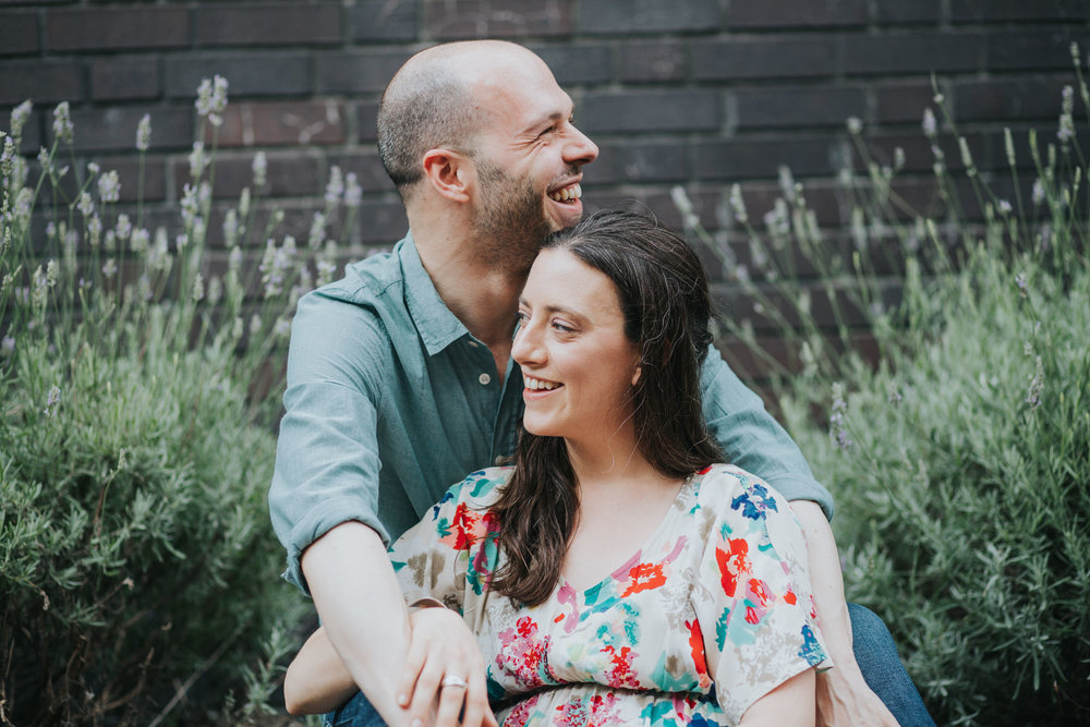 24-couple sitting in lavender bush Southbank engagement session_.jpg