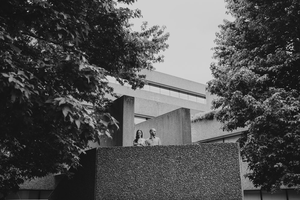 43-couple portrait shoot brutalist architecture green trees Southbank.jpg