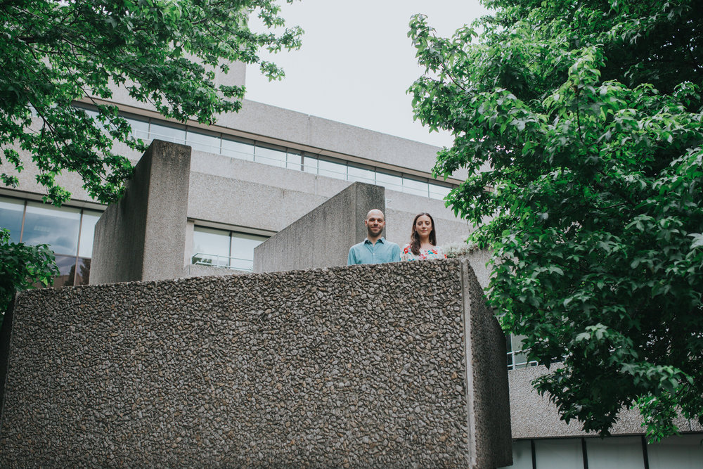 46-couple portrait shoot brutalist architecture green trees Southbank.jpg
