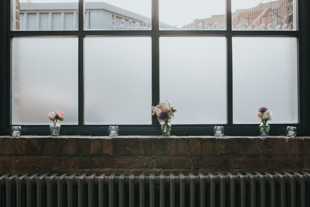17-St Chads Place wedding small flower posies in window.jpg