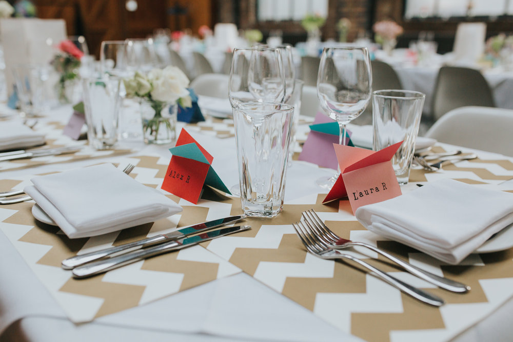 28-St Chads Place wedding gold chevron table mulit colour geometric place names.jpg