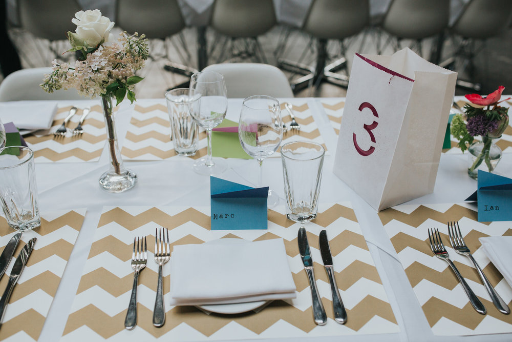 27-St Chads Place wedding gold chevron table mulit colour geometric place names.jpg