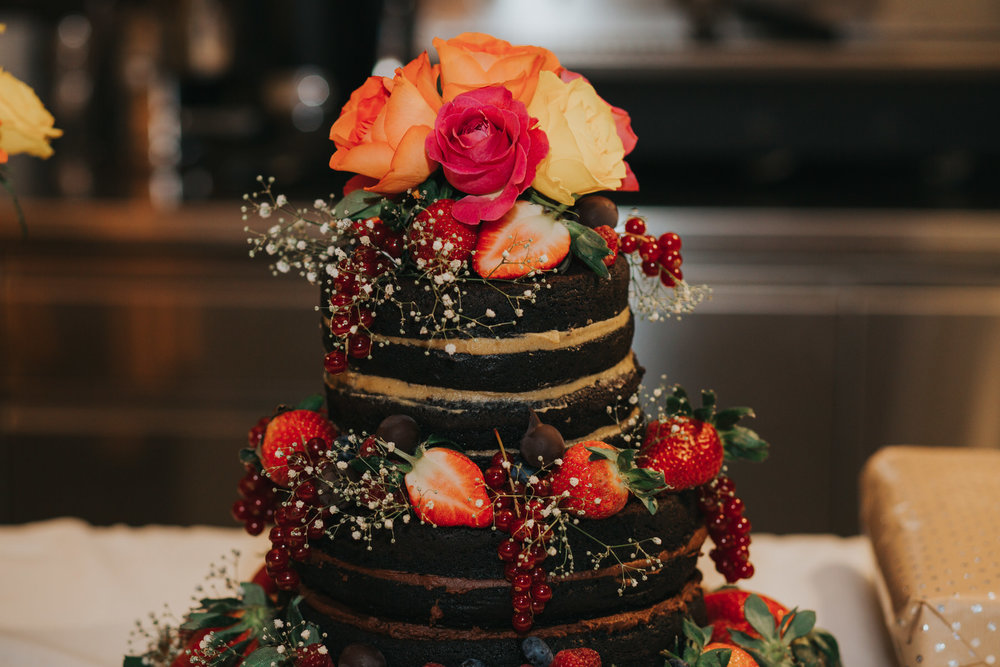146.1-St Chads Place chocolate wedding cake decorated fresh roses strawberries babies breath.jpg