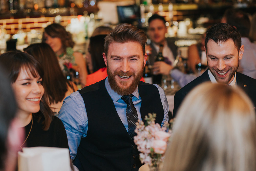 172-St Chads Place wedding guests laughing.jpg