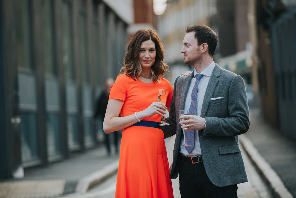 33-St Chads Place golden hour relaxed wedding portraits couple drinking bubbles.jpg