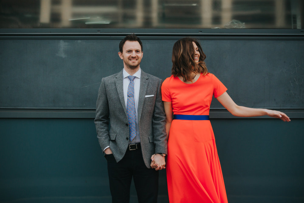 52-St Chads Place urban couple portrait bride neon orange dress.jpg