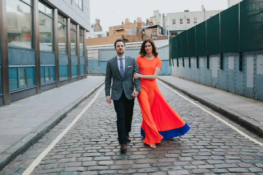 62-St Chads Place London wedding couple walking.jpg