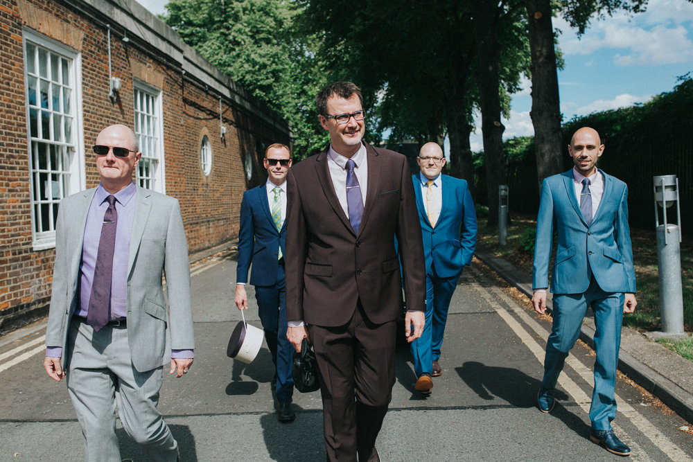 30 grooms bestmen brothers walking to Trafalgar Tavern Wedding.jpg