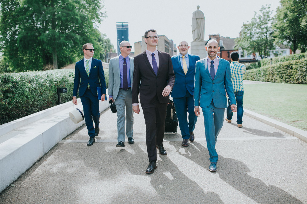 31 two grooms walking to Trafalgar Tavern wedding with brothers bestmen.jpg