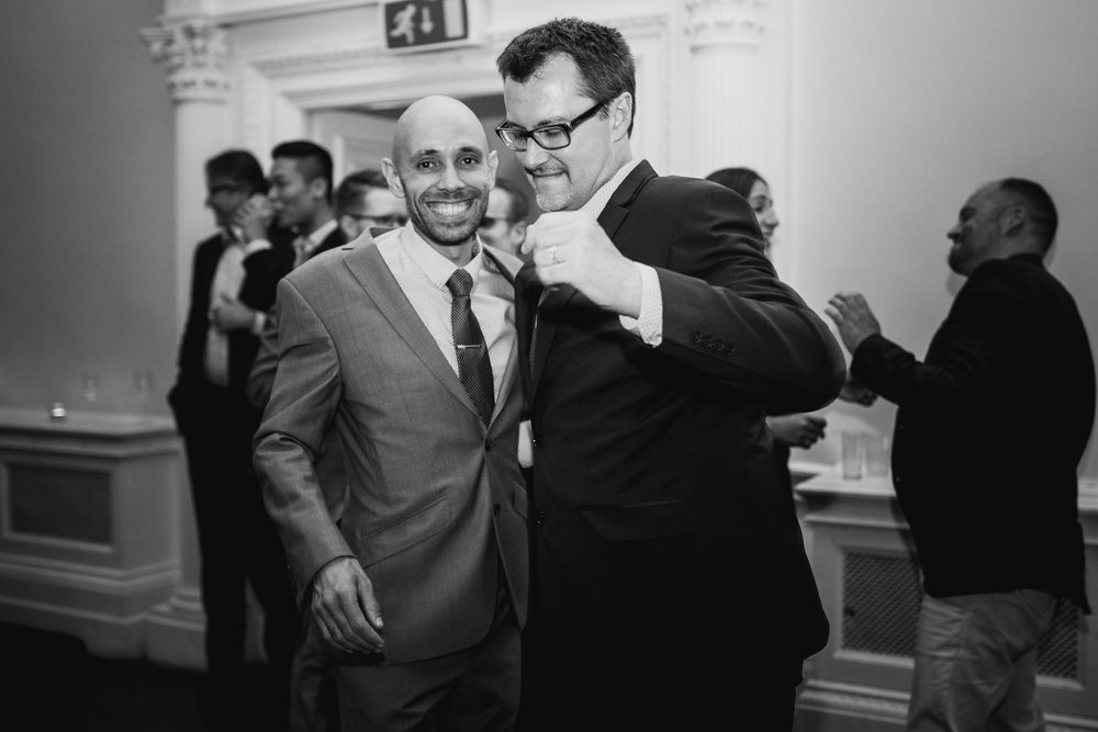 236 newly married grooms dancing together gay wedding London.jpg