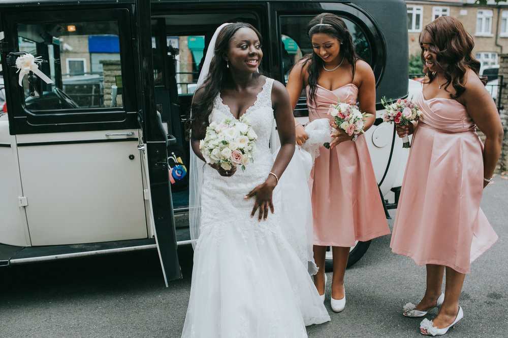 59-bride steps out of wedding car bridesmaid in pink St Thomas More Church.jpg