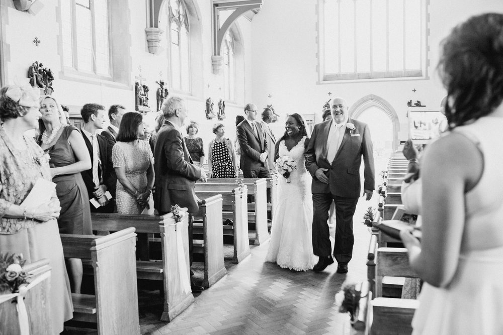 63 bnw brides walking dow aisle father Dulwich church wedding.jpg