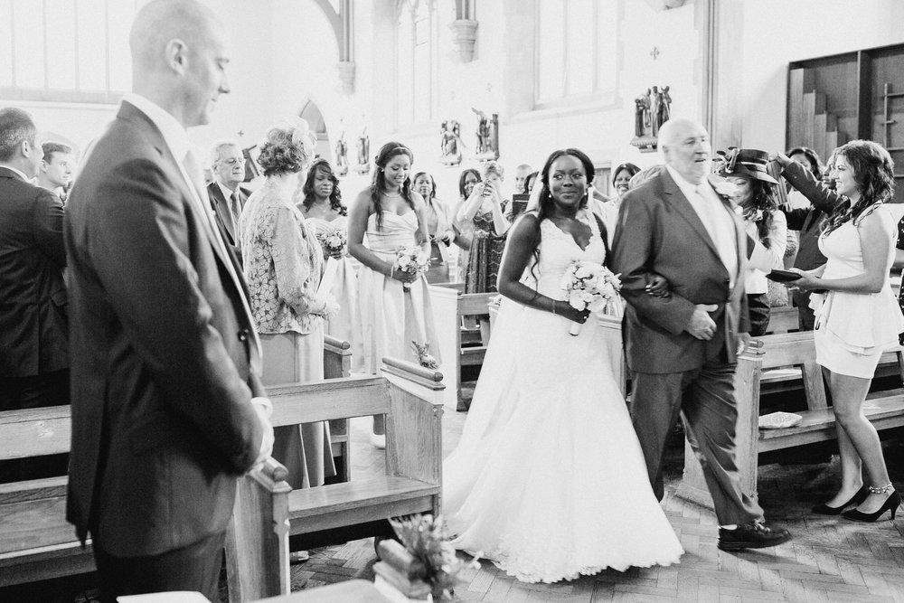 64 bride glances groom Church Dulwich wedding photographer.jpg