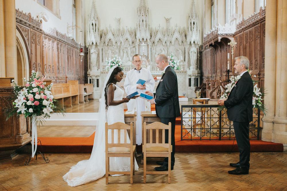 74 Catholic Church wedding bride groom priest vows.jpg