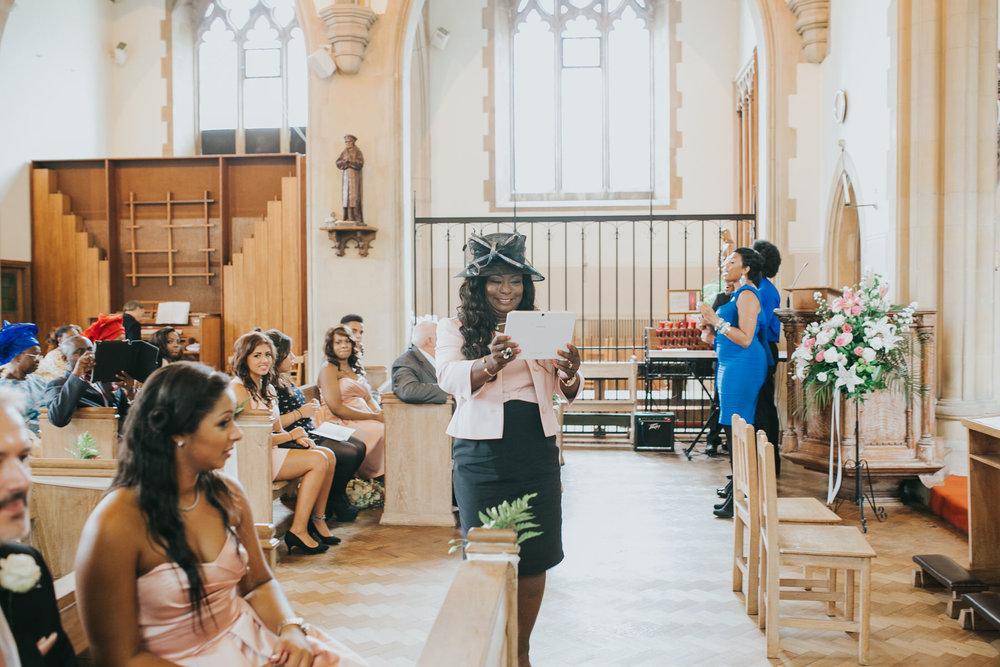 78 mother of bride taking wedding photos on ipad.jpg