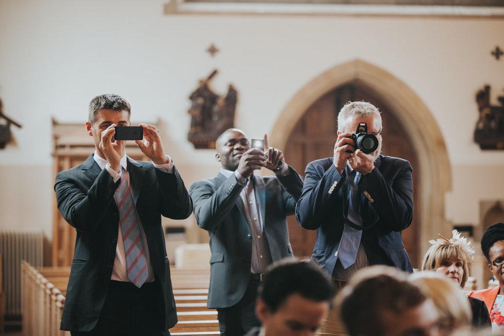 84 guests taking photos of bride groom.jpg