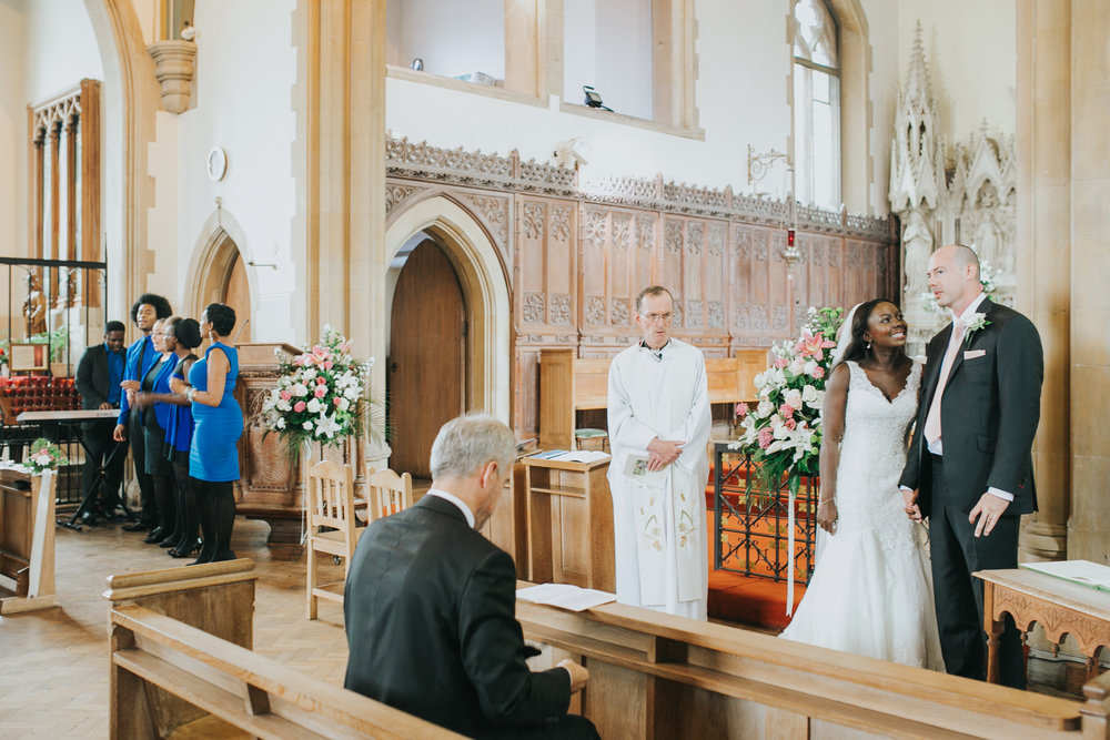 85 St Thomas More Church documentary wedding photographer.jpg