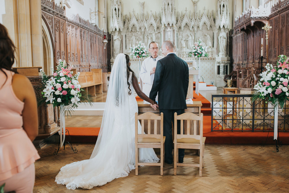 86 bride groom final blessings Church Dulwich wedding photographer.jpg