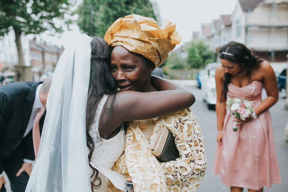 93 grandma holding bride Dulwich documentary wedding photographer.jpg