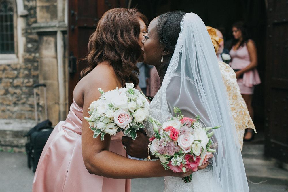 91 bridesmaid embracing bride Dulwich wedding photographer.jpg