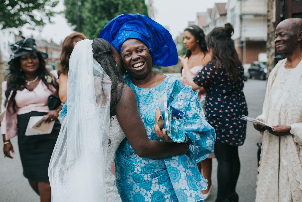 95 documentary style wedding photography emotional bride hugging aunt.jpg