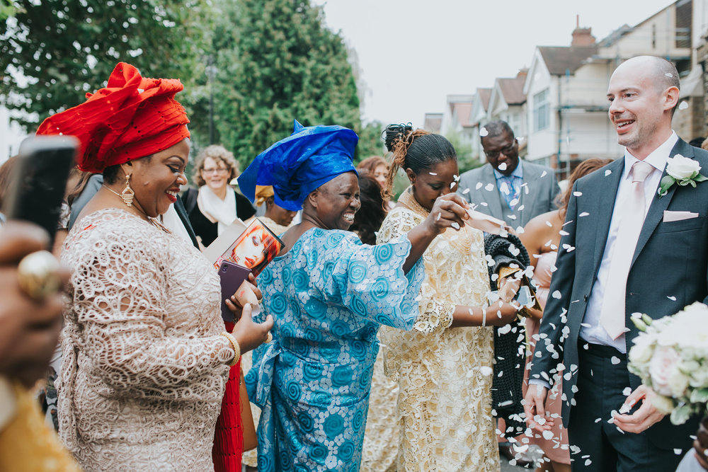 106 brides family throwing confetti Dulwich wedding photographer.jpg