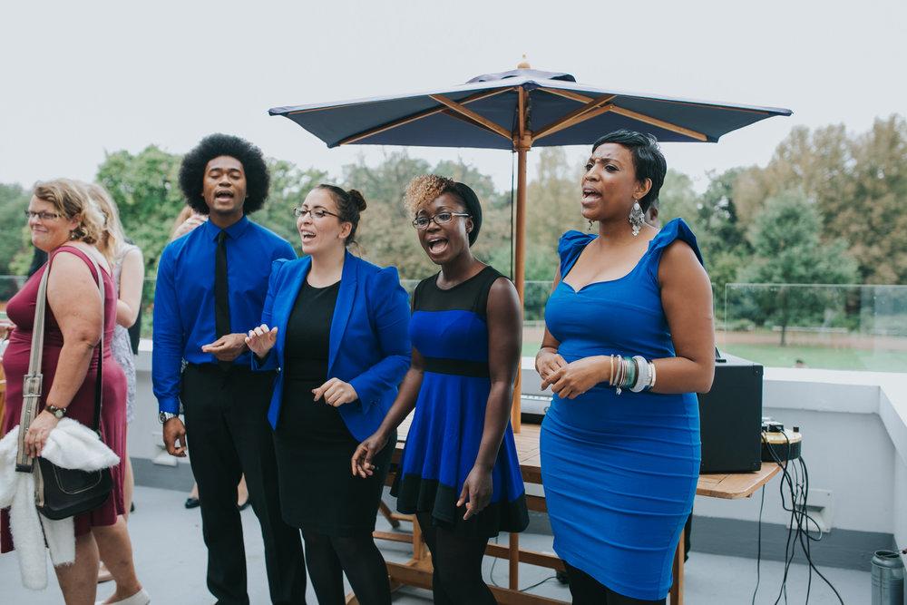 138-Belair House wedding reception gospel singers wearing blue.jpg