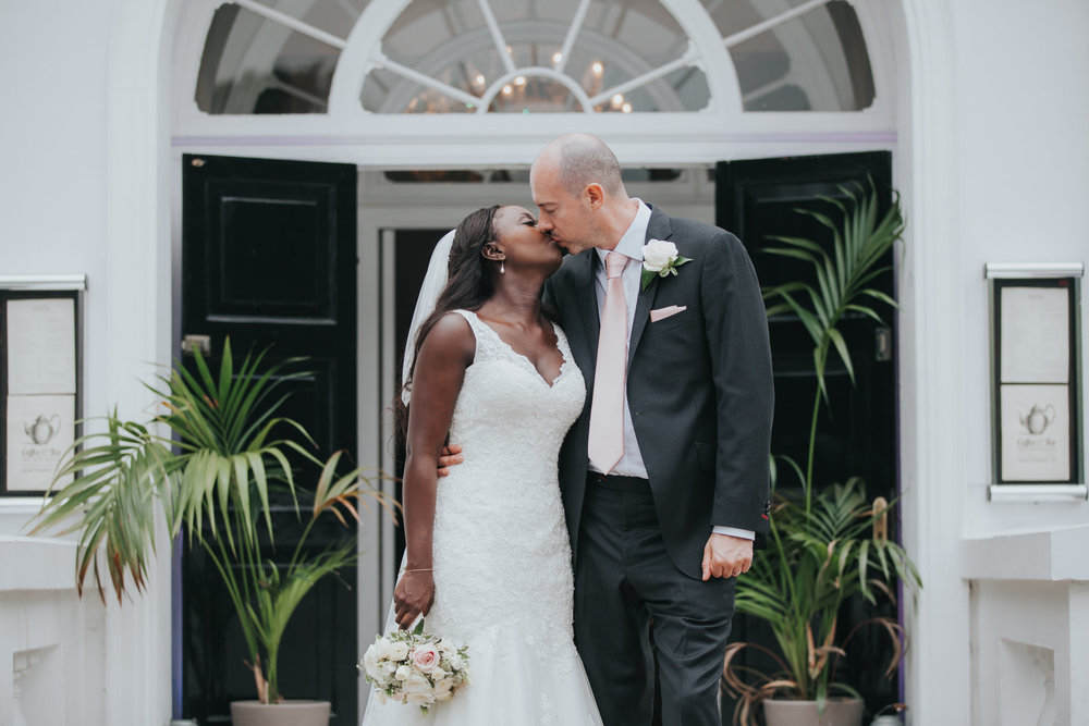 161 Belair House groom bride kissing on front steps.jpg