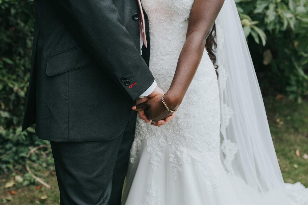 179 groom holding brides hand wedding portraits.jpg