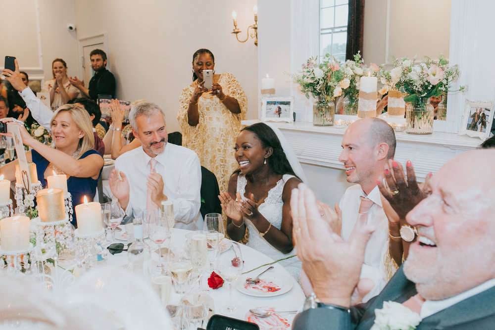 254 Belair House wedding breakfast bride enjoying singing waiters.jpg