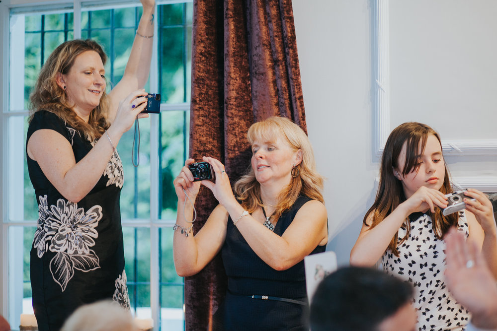 264 wedding guests snapping with digital cameras.jpg