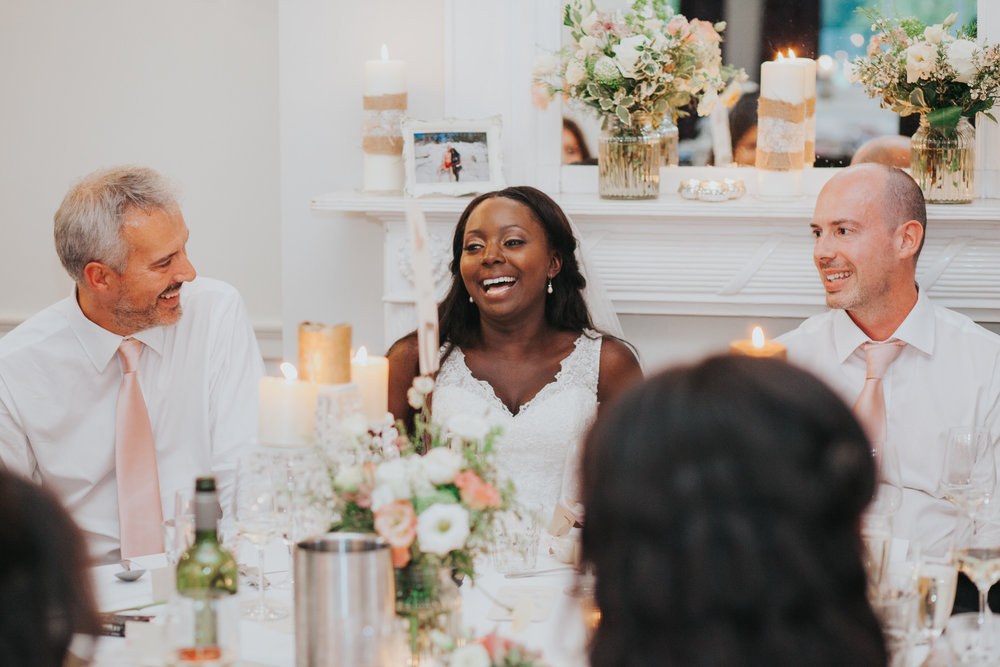 273 bride laughing wwith groom during speeches.jpg