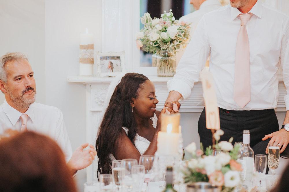 278 brides reacts to groom during wedding speech.jpg