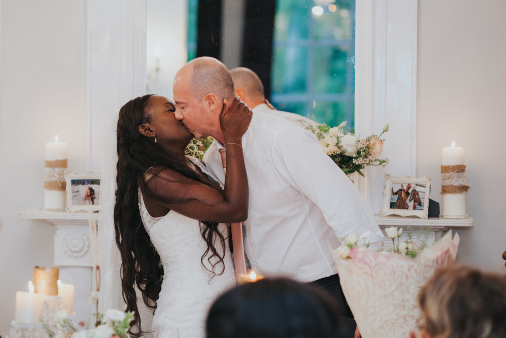 282 Dulwich wedding bride kissing groom.jpg