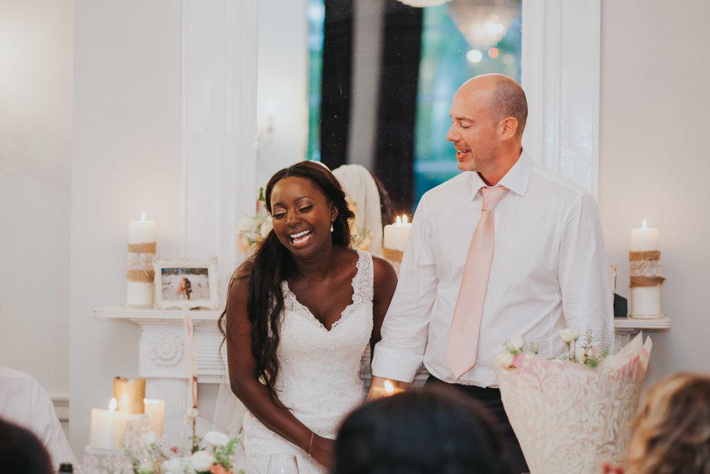 283 Dulwich wedding breakfast bride groom laughing.jpg