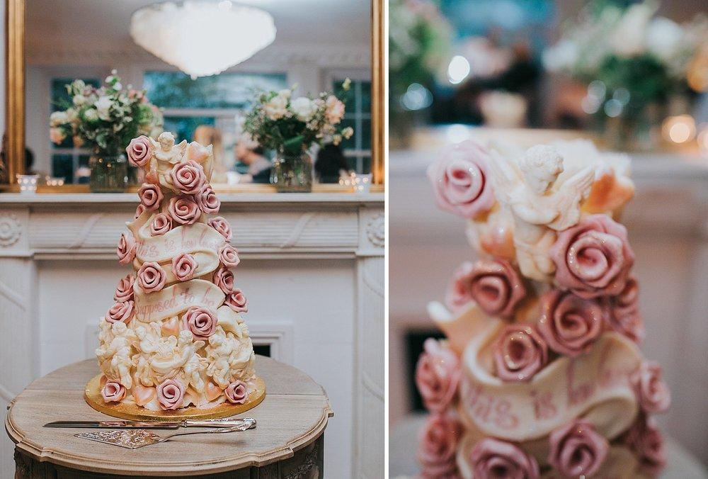 291- Choccywoccydoodah wedding cake pink roses cream cherubs.jpg