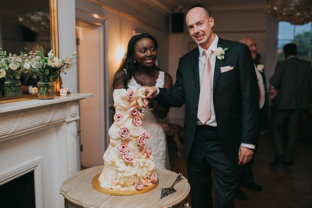 300-Belair House bride groom cutting  Choccywoccydoodah wedding cake.jpg