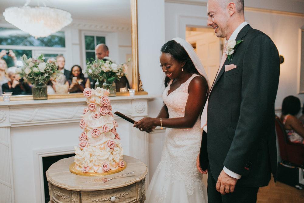 301-Belair House bride groom cutting  Choccywoccydoodah wedding cake.jpg