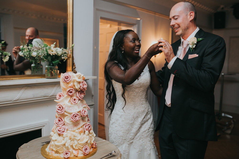 302-Belair House bride groom cutting  Choccywoccydoodah wedding cake.jpg