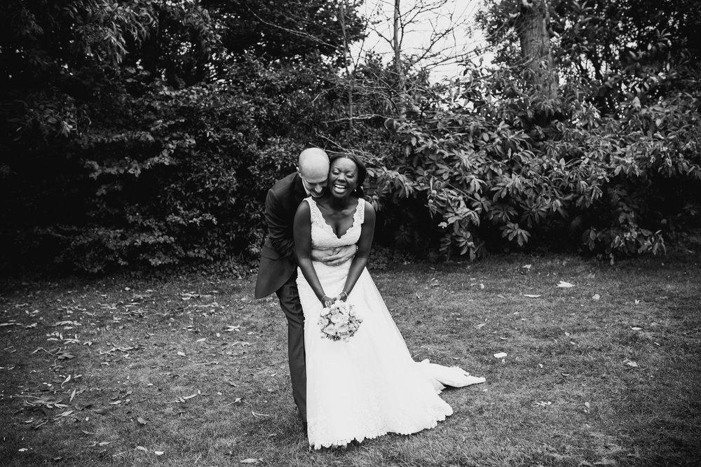 213 bnw groom surprising bride during wedding portraits.jpg