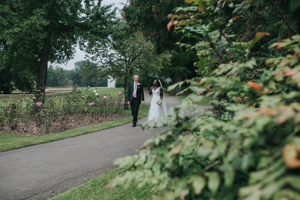 221 Belair Park Dulwich groom bride walking.jpg