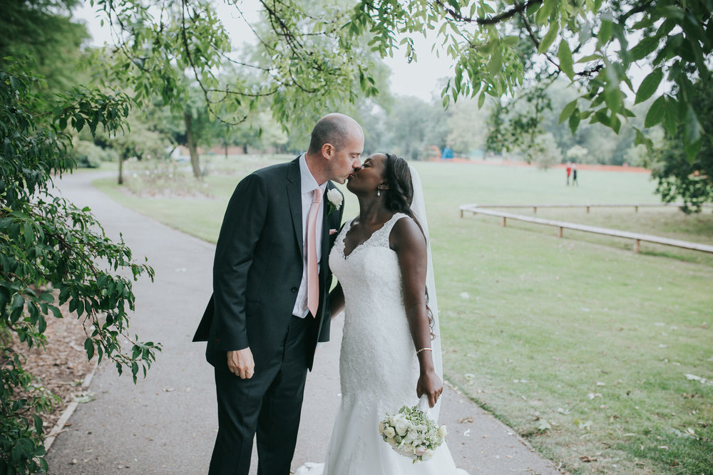 243 groom bride kissing Belair Park Dulwich.jpg