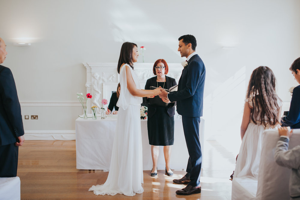 bride exchanging vows with groom during Asia House wedding ceremony