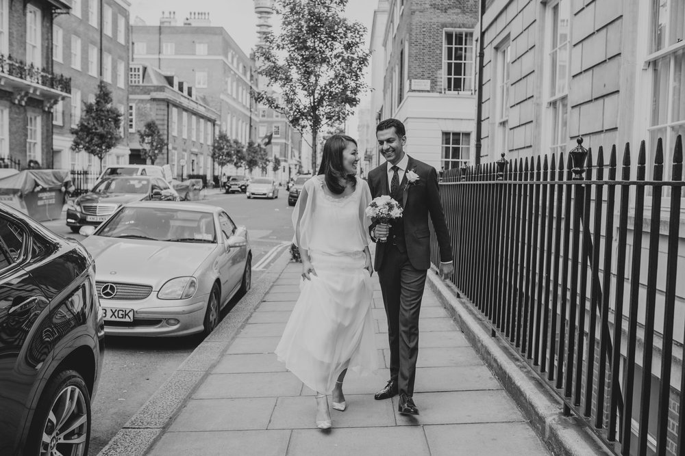 BNW wedding reportage couple walking on street
