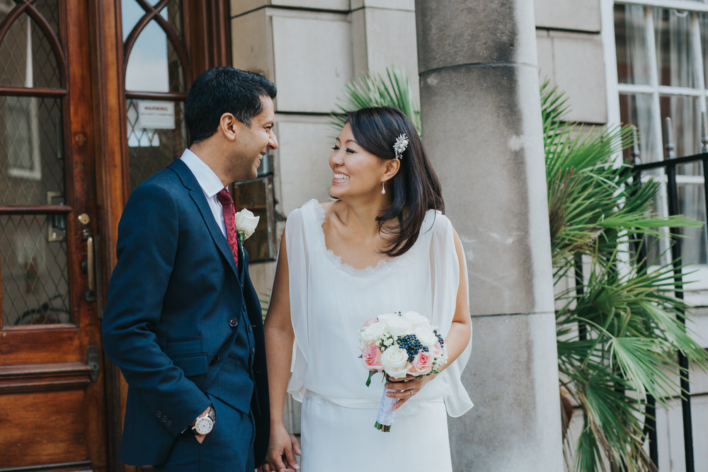 natural reportage wedding photo of bride groom London Marylebone